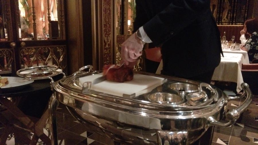 Waiter Slicing Pork Belly the Grill at the Dorchester